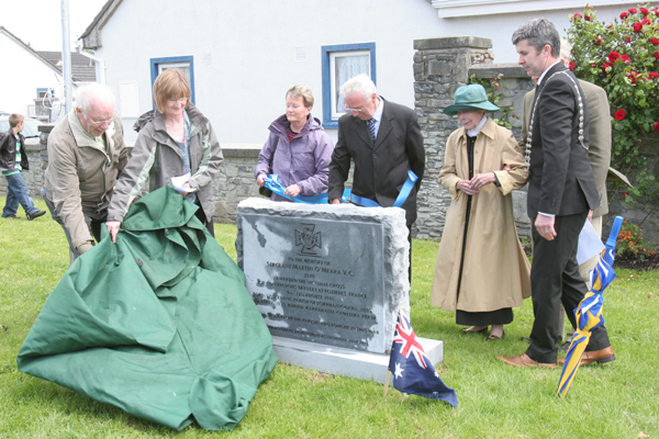 Noreen O'Meara, grandniece of Martin V.C. unveils a plaque to hismemory in Lorrha.